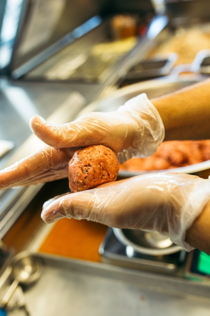 meatball being prepared at capriotti's sandwich franchise