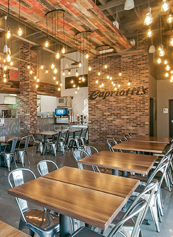 Capriotti's interior with hanging Edison lights
